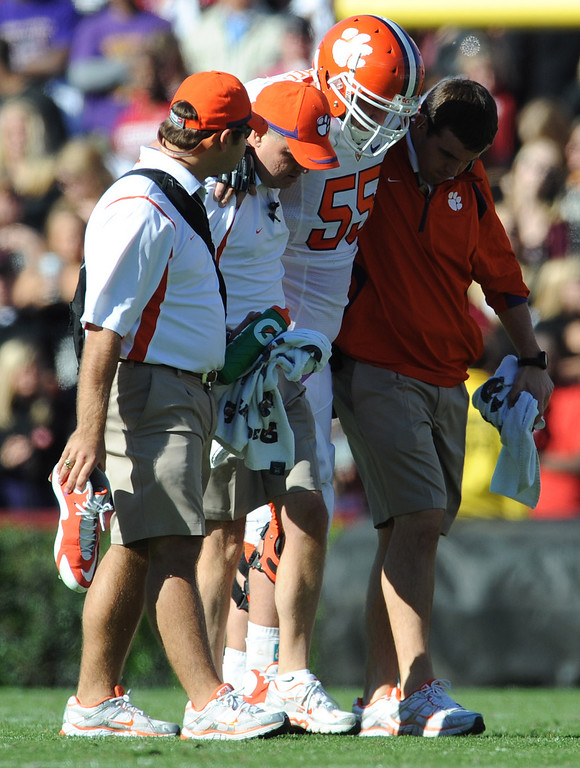 Clemson center Dalton Freeman (55) is helped from the field after being injured during the second quarter while playing South Carolina Saturday, November 28, 2009 at Carolina's Williams Brice Stadium in Columbia.
