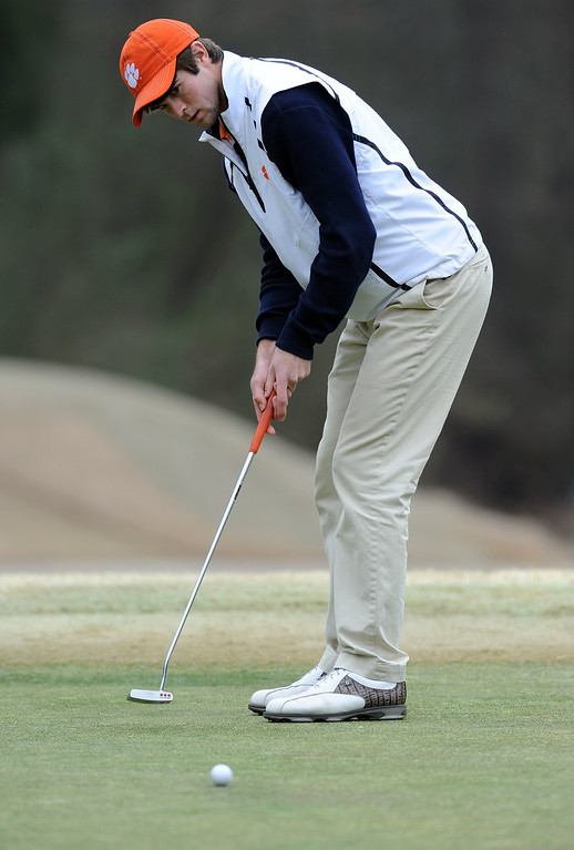 Clemson golfer Hayden Garrett practices at Cross Creek golf course in Seneca Friday, February 10, 2012. BART BOATWRIGHT/Staff