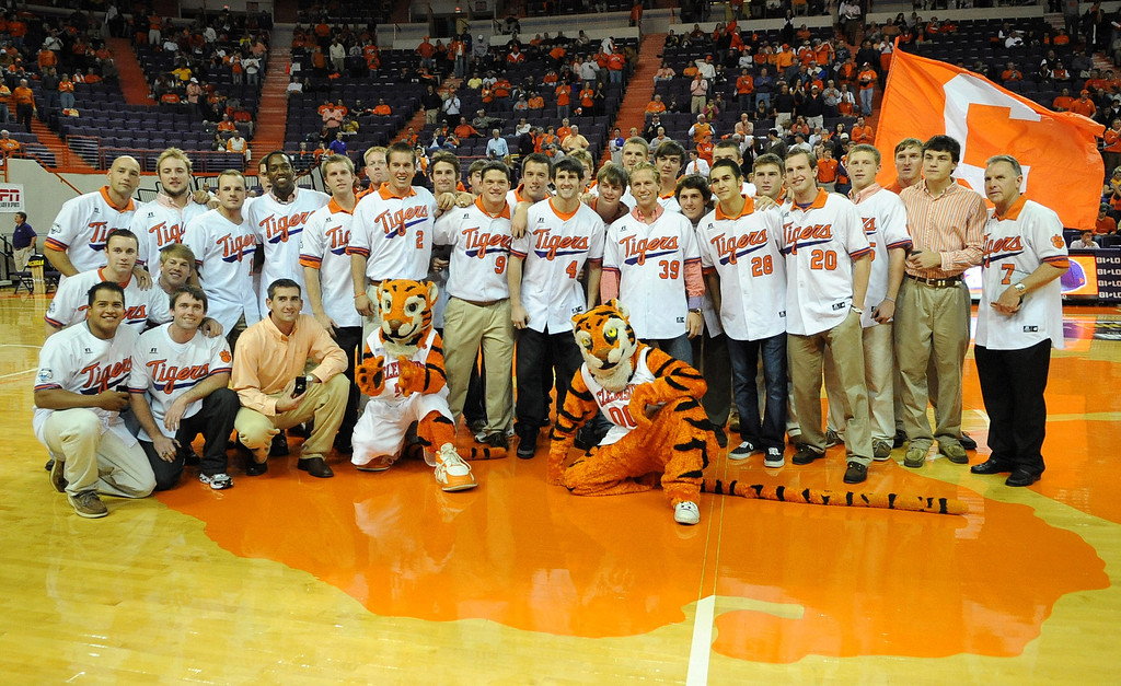 Clemson athletic director Terry Don Phillips presents members of the baseball team rings during a ceremony Tuesday, November 30, 2010 at Clemson's Littlejohn Coliseum to honor their team who went to the College World Series last June. BART BOATWRIGHT/Staff