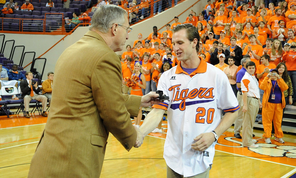 Clemson athletic director Terry Don Phillips presents members of the baseball team rings during a ceremony Tuesday, November 30, 2010 at Clemson&#39;s Littlejohn Coliseum to honor their team who went to the College World Series last June. BART BOATWRIGHT/Staff