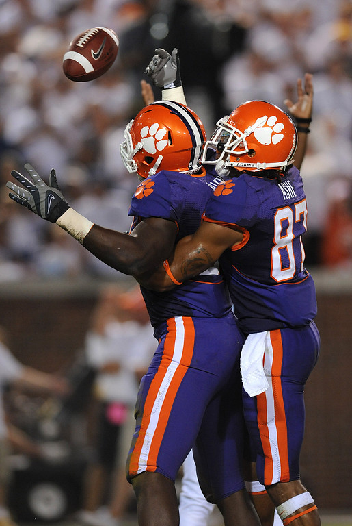 Clemson tight end Dwayne Allen (83), left, celebrates with teammate wide receiver Terrance Ashe (87) after catching a TD pass against Georgia Tech during the 3rd quarter at Tech's Bobby Dodd Stadium Thursday, Sept. 10, 2009 in Atlanta, Ga.