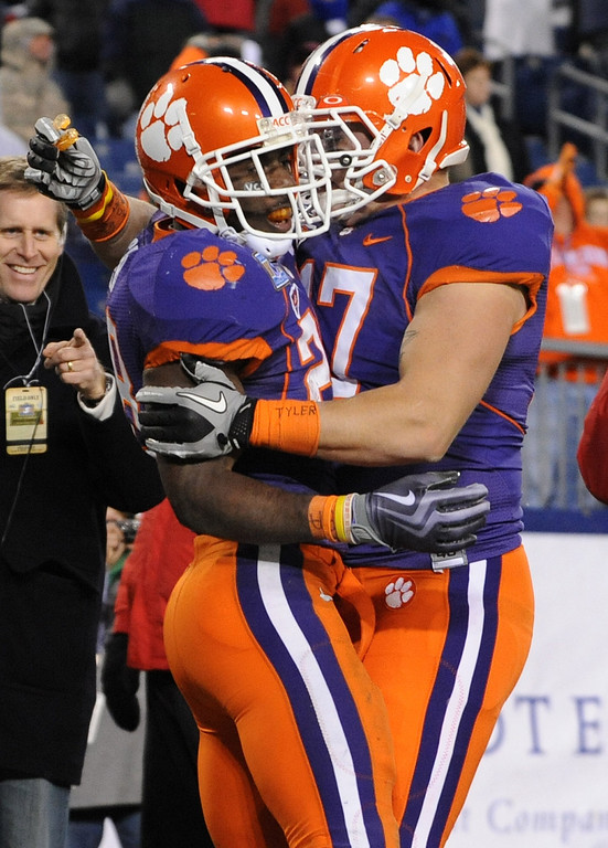 Clemson running back C.J. Spiller (28) celebrates with teammate Clemson FB Chad Diehl (17) after scoring a TD against Kentucky during the 4th quarter of the Gaylord Hotels Music City Bowl Sunday, December 27, 2009 at LP Field in Nashville, Tenn.