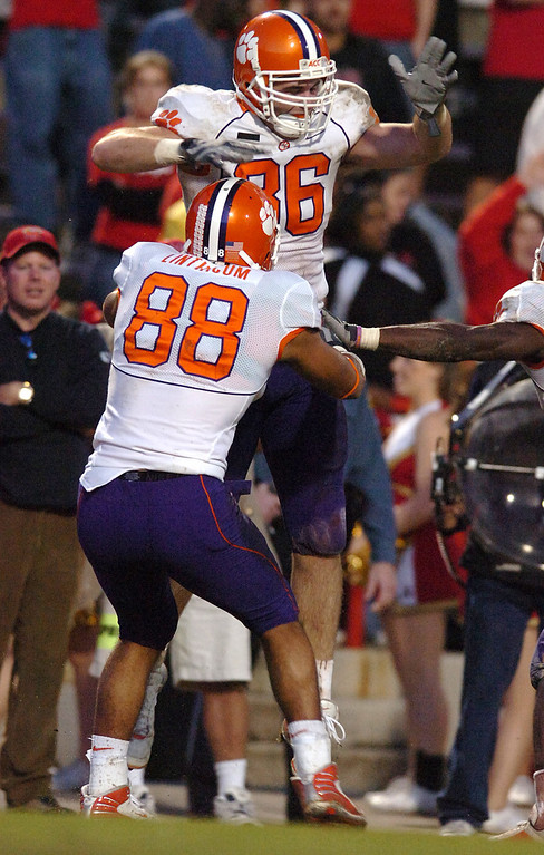 Clemson's Michael Palmer (86) celebrates with teammate Brian Linthicum (88) after catching a 3 yard TD pass against Maryland during the 4th quarter at Byrd Stadium in College Park, MD.