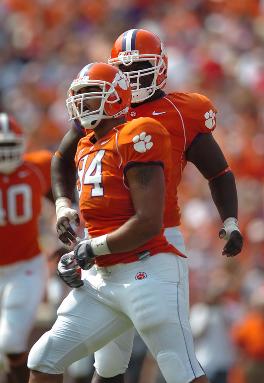 Clemson's Phillip Merling celebrates with teammate Dorell Scott after sacking the Florida Atlantic QB for a loss of 6 yards in the 1st quarter Saturday, September 2, 2006 in Clemson, SC.