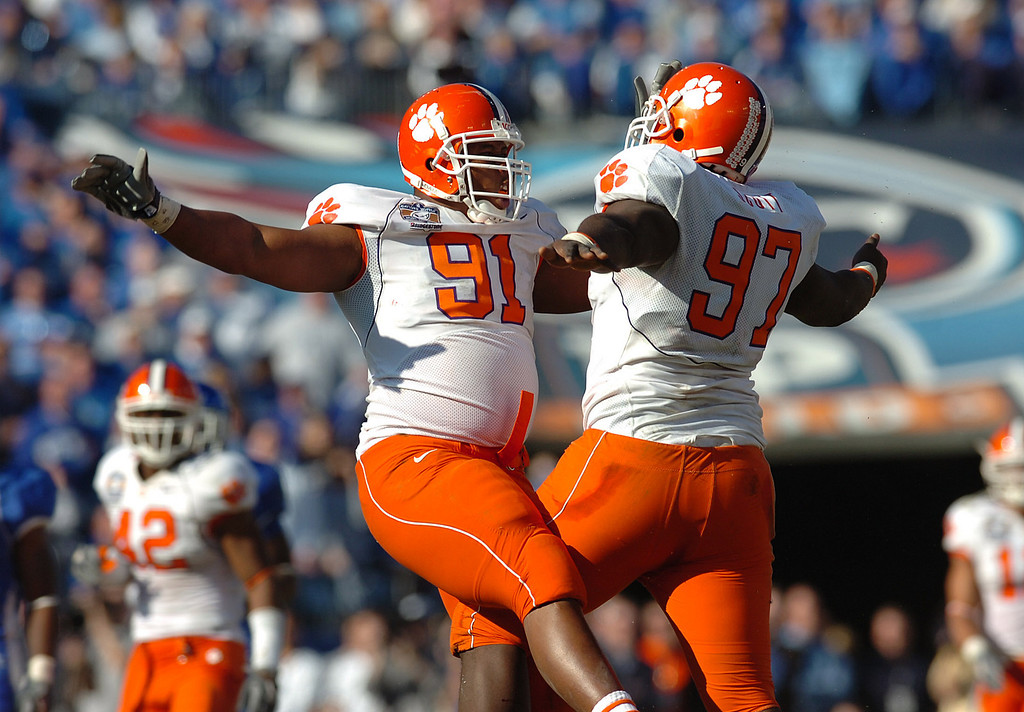 Clemson's Dorell Scott, right, celebrates with teammate Rashaad Jackson after Scott sacked Kentucky's quarterback during the 1st quarter of the Music City Bowl Friday, Dec. 29, 2006 in Nashville, TN.