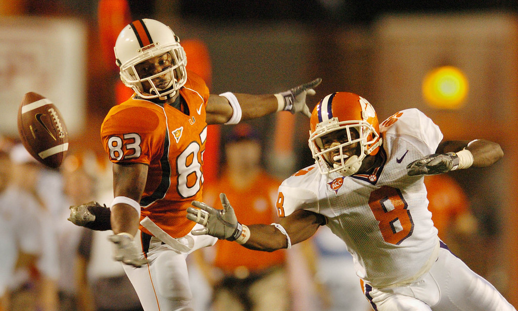 Clemson's Tye Hill breaks up a pass to Miami's Sinorice Moss during the 1st quarter Saturday, November 6, 2004 at the Orange Bowl in Miami Fl.