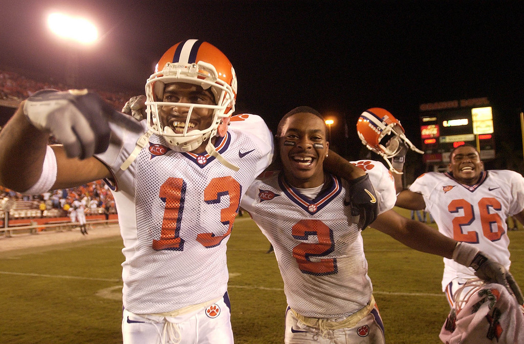 Clemson's Gerald McCloud (13), Chansi Stuckey (2) and La'Donte Harris celebrate the Tigers 24-17 OT win over Miami Saturday, November 6, 2004 at the Orange Bowl in Miami Fl.
