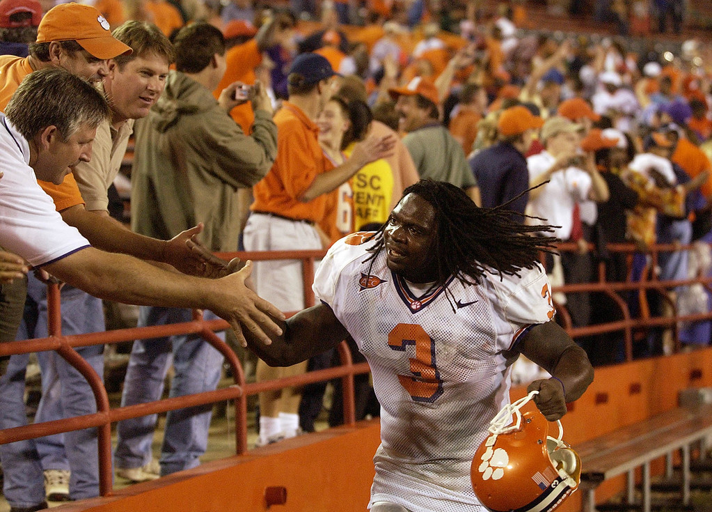 Clemson's Duane Coleman celebrates with Clemson fans after the Tigers beat Miami 24-17 in OT Saturday, November 6, 2004 at the Orange Bowl in Miami Fl.
