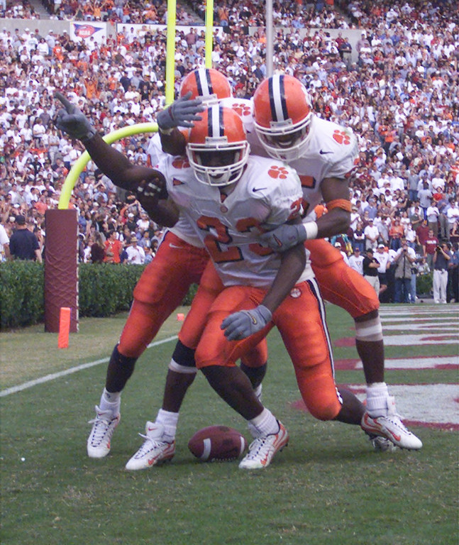 Clemson's Rod Gardner (23) celebrates a TD with teammates Mal Lawyer (84) and Brian Wofford (25) during the 1st half Saturday, November 20, 1999.