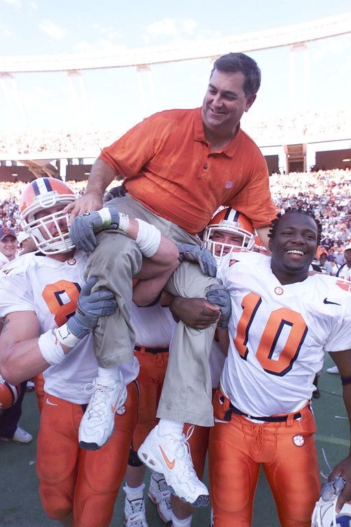 Clemson assistant coach Brad Scott is carried off the field by Jason LeMay (89) and Chad Jasmin (10) after the Tigers 31-21 win over South Carolina Saturday, November 20, 1999.