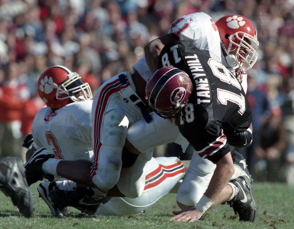 South Carolina QB Steve Taneyhill is brought down by Clemson&#39;s defense Saturday, November 18, 1995 at Carolina&#39;s Williams Brice Stadium in Columbia. The Tigers won the game 38-17.
