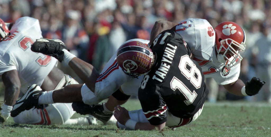 South Carolina QB Steve Taneyhill is brought down by Clemson's defense Saturday, November 18, 1995 at Carolina's Williams Brice Stadium in Columbia. The Tigers won the game 38-17.