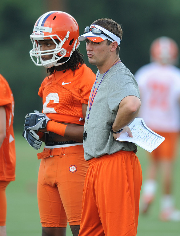 Clemson assistant coach Jeff Scott stands with receiver DeAndre Hopkins (6) during the teams first practice of the season Tuesday, August 4, 2010 at the teams practice field in Clemson. BART BOATWRIGHT / Staff