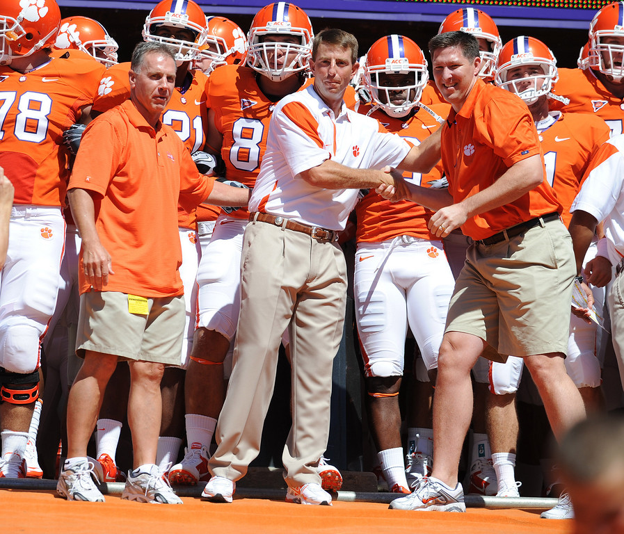 Clemson head coach Dabo Swinney stands at the top of the hill with baseball head coach Jack Leggett, left, and basketball head coach Brad Brownell before the Tigers game against North Texas at Clemson's Memorial Stadium Saturday, September 4, 2010. Staff/Bart Boatwright