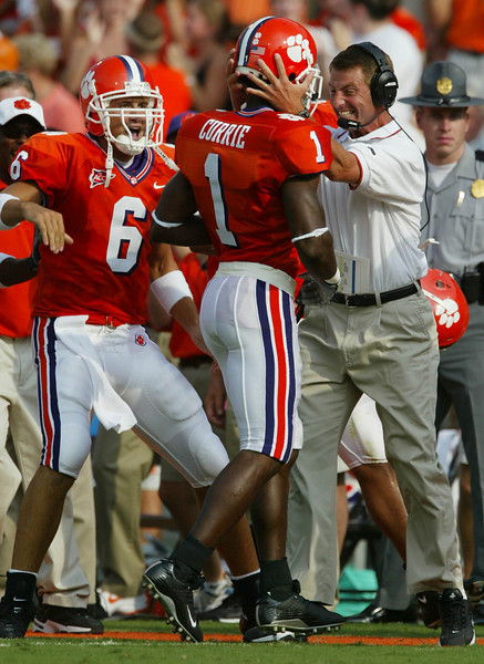 Clemson's Airese Currie celebrates with wide receiver coach Dabo Swinney and quarterback Charlie Whitehurst (6) after catching a 72-yard touchdown pass against Furman Saturday, September 6, 2003 at Clemson's Memorial Stadium.